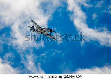 SAN ANTONIO, USA - October 31, 2015: WW2 Plane P-51 Mustang Diving (Public Event) - stock photo