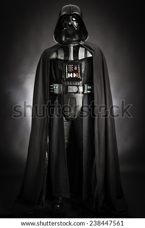SAN BENEDETTO DEL TRONTO, ITALY. DECEMBER 5, 2014.Studio portrait of Darth Vader costume replica . Darth Vader or Dart Fener is a fictional character of Star Wars saga. Black background - stock photo