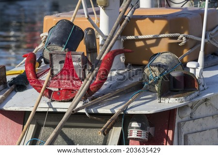 SAN BENEDETTO DEL TRONTO, ITALY - JUN 3: fishing boats  on jun 3, 2014  in the harbor of San Benedetto del Tronto, Italy. Detail of boat: horns and red panties on the cockpit.