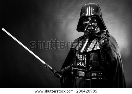 SAN BENEDETTO DEL TRONTO, ITALY. MAY 16, 2015. Portrait of Darth Vader costume replica with grab hand and his sword . Lord Fener is a fictional character of Star Wars saga.  Black and white picture - stock photo