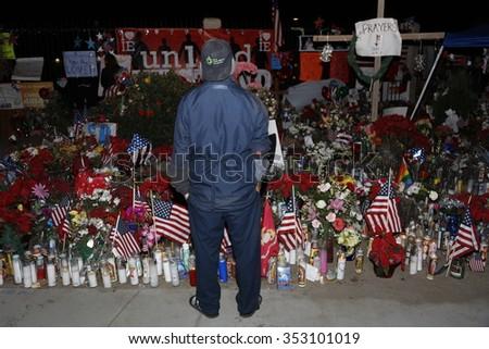 SAN BERNARDINO, CA. DECEMBER 17, 2015, Man honors makeshift memorial at the Inland Regional Center (IRC) in San Bernardino, CA. San Bernardino shooting aftermath in San Bernardino, CA. - stock photo