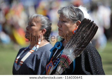 SAN BERNARDINO, CALIFORNIA - OCTOBER 13: The San Manuel Band of Indians hold their annual Pow Wow on October 13, 2012 in San Bernardino. Dances include the Grass, Chicken and Fancy dances. - stock photo