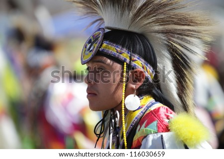 SAN BERNARDINO, CALIFORNIA - OCTOBER 13: The San Manuel Band of Indians hold their annual Pow Wow on October 13, 2012 in San Bernardino. A tribal warrior wearing a Fancy Dancer head dress. - stock photo