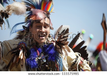SAN BERNARDINO, CALIFORNIA, USA, OCTOBER 13, 2012.  The San Manuel Band of Indians hold their annual Pow Wow in San Bernardino on October 13, 2012. Feathers in a costume are indications of bravery. - stock photo
