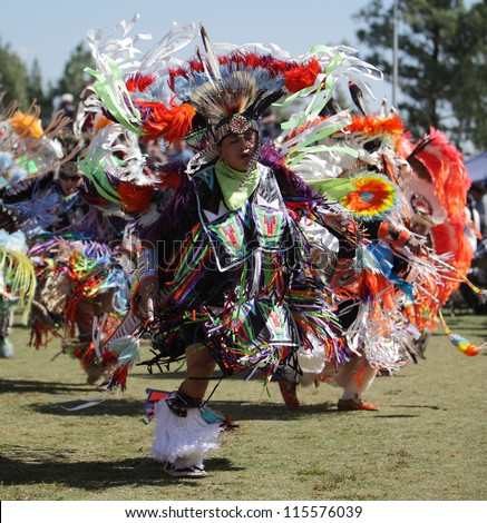 SAN BERNARDINO, CALIFORNIA, USA, OCTOBER 13, 2012.  The San Manuel Band of Indians hold their annual Pow Wow in San Bernardino on October 13, 2012. A Fancy Dancer in full regalia competes for prizes. - stock photo
