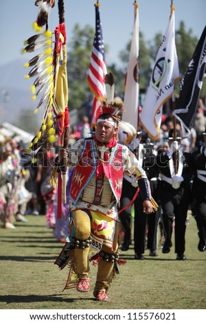 SAN BERNARDINO, CALIFORNIA, USA, OCTOBER 13, 2012. The San Manuel Band of Indians hold their annual Pow Wow in San Bernardino on October 13, 2012. A tribal warrior opens the ceremony carrying a spear. - stock photo