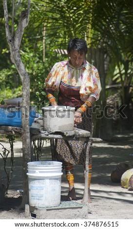 San Blas, Kuna Yala, Panama - October 25: Kuna Indians dressed in traditional costume , cooking traditional way. October 25, 2008 in Kuna Yala, Panama.  - stock photo