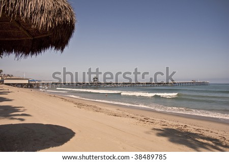 San Clemente beach with the pier from a palapa. - stock photo