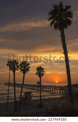 San Clemente Pier Sunset with Palms - stock photo