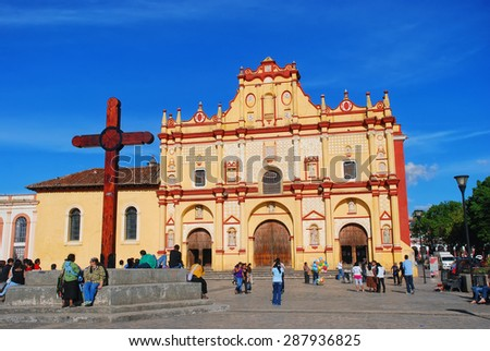 SAN CRISTOBAL DE LAS CASAS, MEXICO - MARCH 19, 2011: Main square in the city with Cathedral and unidentified people. It is a cultural capital of Chiapas with Spanish colonial architecture - stock photo