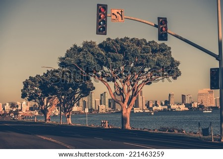 San Diego Bay Road and the Skyline. Harbor Island Drive, San Diego, California, USA. Vintage Color Grading. - stock photo