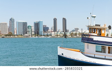 San Diego bay skyline and ferry boat. Public transportation to carry people across the water. Nice photo for a travel brochure. Plenty of room for text, copy space.   - stock photo