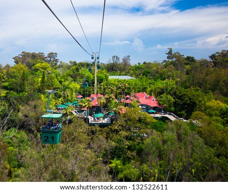 SAN DIEGO, CA - AUG 13:  Skyfari aerial cable car over San Diego Zoo on Aug 13, 2012. This world renowned zoo was founded on October 2, 1916. - stock photo