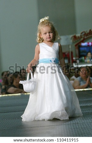 SAN DIEGO, CA - AUGUST 12: An unidentified child model walks the runway during the San Diego Bridal Bazaar at the San Diego Convention Center in San Diego, CA on August 12, 2012.