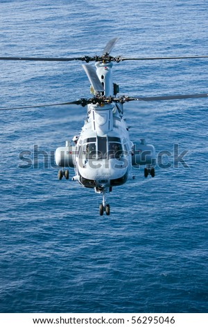SAN DIEGO, CA - FEB 11:  A CH-46E Marine Corps helicopter departs for a training mission prior to deployment at the Marine Corps Air Base in San Diego, CA on Feb 11, 2010. - stock photo