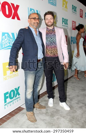 "SAN DIEGO, CA - JULY 10: ""Salem"" creator Adam Simon and actor Seth Gabel arrive at the 20th Century Fox/FX Comic Con party at the Andez hotel on July 10, 2015 in San Diego, CA. - stock photo"