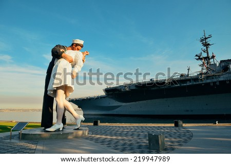 San Diego, CA - MAY 18: Unconditional Surrender sculpture at sea port on May 18, 2014 in San Diego. By Seward Johnson, the statue resembles the photograph of V-J day in Times Square - stock photo