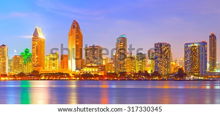 San Diego California, city skyline at sunset on a beautiful summer night with lighted skyscrapers and downtown buildings - stock photo