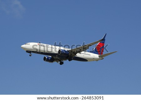 SAN DIEGO, CALIFORNIA - SEPTEMBER 27, 2014: Delta Airlines Boeing 737 jet descending for landing San Diego International Airport.