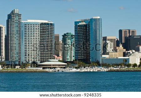 San Diego, California skyline as seen from the bay. The Marriott Hotel and Marina are in the center of this photograph. - stock photo