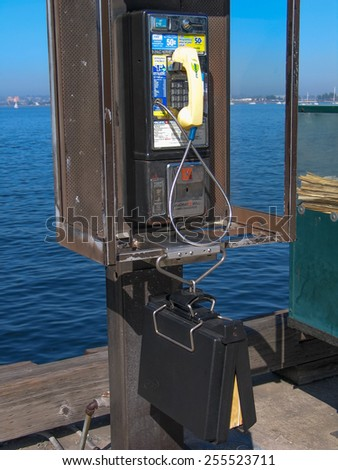 SAN DIEGO, CALIFORNIA, US - MARCH 11, 2007: Old public pay phone booth in San Diego California, US on March 11, 2007.  - stock photo