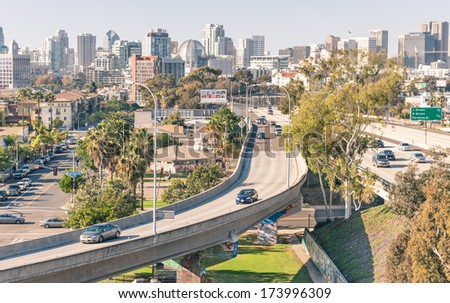 SAN DIEGO - DECEMBER 20, 2013: highway leading to San Diego downtown viewed from Coronado Bridge. The value of tourism to the city helped the development of roads, since 70% of tourists arrive by car. - stock photo