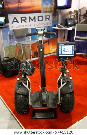 SAN DIEGO - JULY 14: Armor Segway featured on the trade floor of the ESRI (Environmental Systems Research Institute) user conference. July 14, 2010 in San Diego California - stock photo