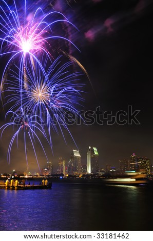 San Diego July 4th celebration fireworks with backdrop of downtown skyline - stock photo