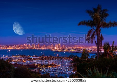 San Diego Night with Large Moon on the Horizon. San Diego Night Time Panorama. California, United States. - stock photo