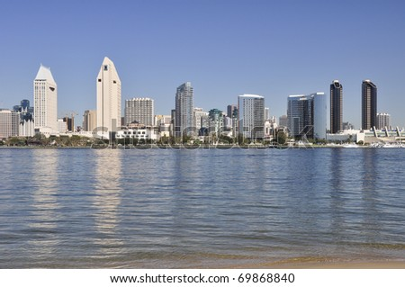 San Diego skyscrapers reflect in the water of the bay as viewed from Coronado. - stock photo