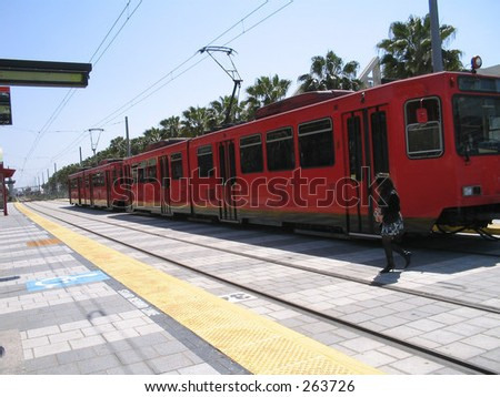 San Diego trolley pulling out of station - stock photo
