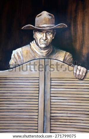 SAN DIEGO USA APRIL 05: John Wayne mural in Old Town San Diego State Historic Park, located in the Old Town of San Diego, California,. On april 05 2015 in San Diego CA USA - stock photo