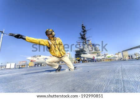 SAN DIEGO,USA - FEBRUARY 24 2014: A statue of a Flight Deck Director, catapult officer, signaling aircrafts into position on the deck, on the USS Midway Museum in San Diego,California, USA - stock photo