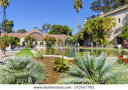 SAN DIEGO,USA - FEBRUARY 23 2014: The Botanical building and lily pond in Balboa park, Southern California in the United States of America on 23/2/2014. A wooden building with plants and flower garden - stock photo