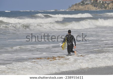 SAN DIEGO USA - SEPTEMBER 1st, 2014: People in San Diego surfing. San Diego is very well known for surfing