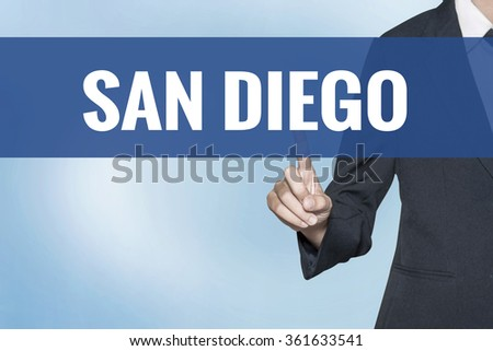 San Diego word on virtual screen touch by business woman blue background - stock photo