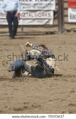 SAN DIMAS, CA - OCTOBER 2: Unidentified cowboy competes in the Saddle Bronc event at the San Dimas Rodeo in San Dimas on October 2, 2010.