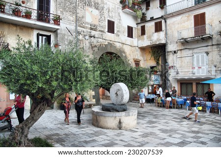 SAN FELICE CIRCEO, ITALY - SEPTEMBER 13, 2014: People in the central square Piazza Vittorio Veneto on a summer evening - stock photo