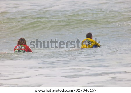 SAN FERNANDO, CADIZ, SPAIN-FEB 19: Unidentified bodyboaders waiting for waves on the 2nd championship of Surf and BodyBoard Impoxibol on Feb 19,2011 on  San Fernando, Cadiz, Spain - stock photo