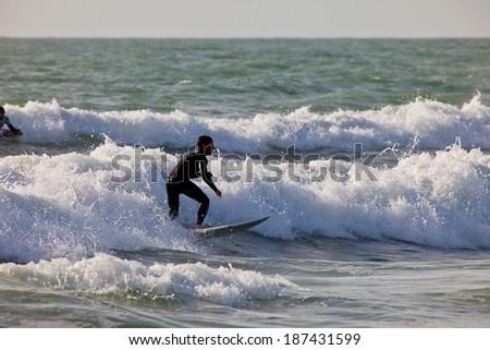 SAN FERNANDO, CADIZ, SPAIN - FEB 19: Unidentified surfer taking waves on the 2nd championship of Surf and BodyBoard Impoxibol on Feb 19,2011 on the beach of Camposoto of San Fernando, Cadiz, Spain - stock photo