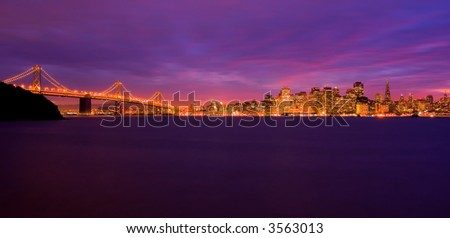 San Francisco and Bay Bridge at night with colorful sky from sunset - stock photo