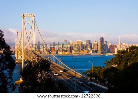 San Francisco and Bay Bridge at sunrise - stock photo