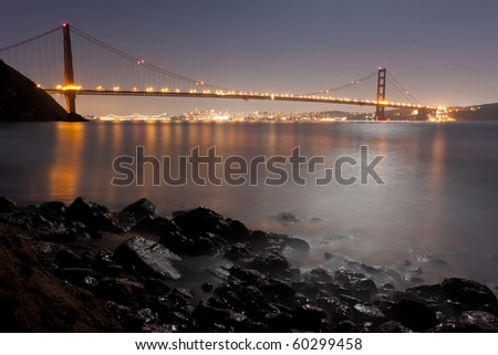 San Francisco and The Golden Gate Bridge under a Beautiful Full Moon Evening - stock photo