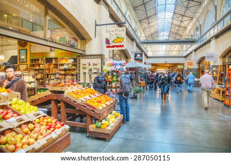 SAN FRANCISCO - APRIL 24: Farmers market hall inside the Ferry building on April 24, 2014 in San Francisco. The market is widely acclaimed for both the quality and diversity of its fresh farm products - stock photo