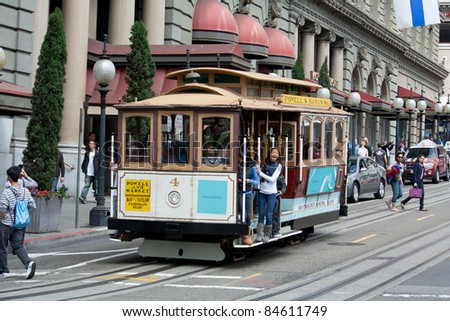 SAN FRANCISCO - AUG 20: Passengers enjoy a ride in a cable car on August 20, 2011 in San Francisco. It is the oldest mechanical public transport in San Francisco which is in service since 1873. - stock photo