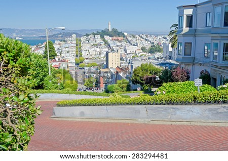 SAN FRANCISCO - AUG 11 : View of Lombard Street in San Francisco California on August 11, 2012. The street is famous for a steep, one-block section with eight hairpin turns - stock photo