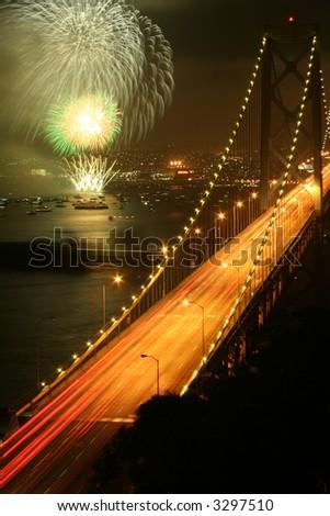 san francisco bay bridge and fireworks - stock photo