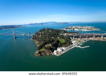 San Francisco Bay bridge and the Treasure Island aerial view - stock photo