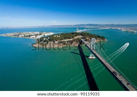 San Francisco Bay bridge and Treasure Island aerial view - stock photo