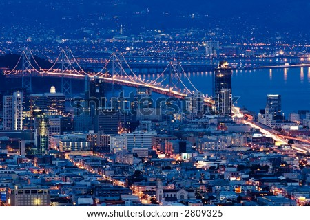 San Francisco Bay Bridge at night aerial view from Twin Peaks. - stock photo